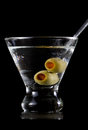 Stemless martini with olives served on a dark background Stock Images