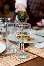 Stemware being filled with wine Royalty Free Stock Photo
