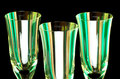Stemware trio against black abstract of flute glasses or champagne side by side and closeup isolated Royalty Free Stock Images