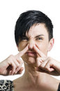 Stench gesturing head and shoulder portrait of a black haired woman middle age in front of white backgroundturn up her nose Stock Image