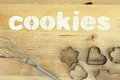 Stencil word cookies made with flour on wooden table Royalty Free Stock Photo