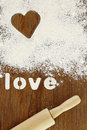 Stencil word love made with flour on wooden table Royalty Free Stock Photo