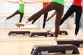 Step aerobics women s leg doing in gym Royalty Free Stock Image