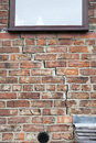 Step cracking to brickwork damage in a wall beneath a window as a result of subsidence Royalty Free Stock Images