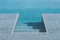 Step down into swimming pool Royalty Free Stock Photo