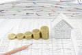 Step of gold coin near and house with pencil Royalty Free Stock Photo