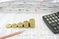 Step of gold coin with pencil and calculator Royalty Free Stock Photo