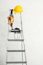 Stepladder near the concrete wall and tools Royalty Free Stock Images