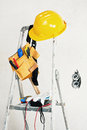 Stepladder next to the concrete wall with tools Royalty Free Stock Photo