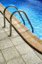 Stepladders to the pool into a of water Stock Photo