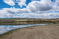 Steppe landscape with a lake which is beautifully reflected sky beautiful reflections of blue and clouds in the small in the sunny Royalty Free Stock Photos