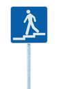 Stepped access entrance to pedestrian underpass subway sign, man walking downstairs stairs signage blue white post pole signpost Royalty Free Stock Photo