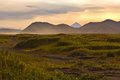 Steppes with mountains after sunset on the horizon in the red light Royalty Free Stock Photography