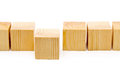 Stepping forward or outstanding concept - row of wood blocks Royalty Free Stock Photo