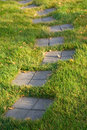 Stepping stone path on grass Royalty Free Stock Images