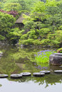 Stepping stones across japanese garden pond circular a in a traditional selective focus on Stock Images