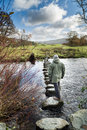 Stepping stones across river rothay near ambleside lake district england Stock Photo