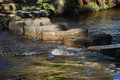Stepping stones closeup of worn crossing river Royalty Free Stock Photography