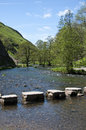 Stepping stones at dovedale the over the river dove in derbyshire Stock Photography