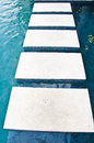 Stepping stones on swimming pool Stock Images