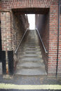 Steps through brick wall at london england uk Stock Photography
