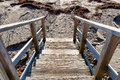 Steps going down to beach wooden leading a gravel and sand in the early morning light Royalty Free Stock Photography