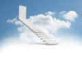 Steps leading to closed door in the sky Royalty Free Stock Photo