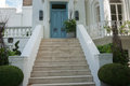 Steps leading up to blue door in stylish residential suburb Royalty Free Stock Photography