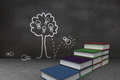 Steps made of books in front of idea tree drawing on blackboard wal Royalty Free Stock Photos
