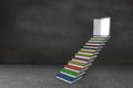 Steps made from books leading to door Stock Image
