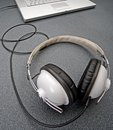 Stereo headphones on a gray table Stock Photos