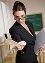 Stern businesswoman holding ruler and notebook Royalty Free Stock Photo