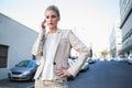 Stern elegant businesswoman on the phone Royalty Free Stock Photo