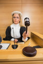 Stern judge banging her hammer in the court room Royalty Free Stock Photo