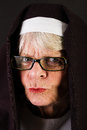 Stern nun a looking with a judging expression Stock Image