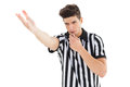 Stern referee blowing his whistle on white background Stock Photography