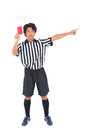 Stern referee showing red card on white background Stock Photography