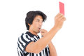 Stern referee showing red card on white background Royalty Free Stock Photo