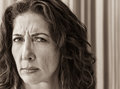Stern woman portrait middle aged frowning and looking askance at the viewer Royalty Free Stock Image