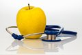 Stethoscope and apple. healthy eating Royalty Free Stock Image