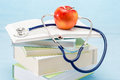 Stethoscope and apple medical healthcare Royalty Free Stock Photo