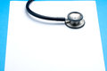 Stethoscope on blank paper or phonendoscope white blue background copy space Stock Photos