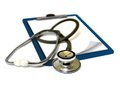 Stethoscope on clipboard over white Stock Photo