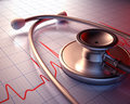 Stethoscope close on a graph of the patient s heartbeat clipping path included Royalty Free Stock Image