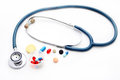 Stethoscope and different pharmacological preparations on a white background Stock Photography