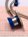 Stethoscope with electrocardiogram graph report medical and ekg heart rhythm medicine concept Stock Photos