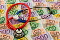 Stethoscope and euro bills symbolic photo for healthcare costs for health medicine Stock Photos