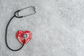 Stethoscope and heart on a gray background