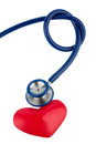 Stethoscope and a heart symbol photo for cardiovascular attack risk Royalty Free Stock Images