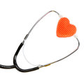 Stethoscope and heart on white background Royalty Free Stock Photography